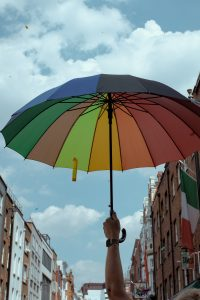 man holding a rainboW umbrella | Mental Health Links | Depression & Addiction Counseling | Orlando, FL